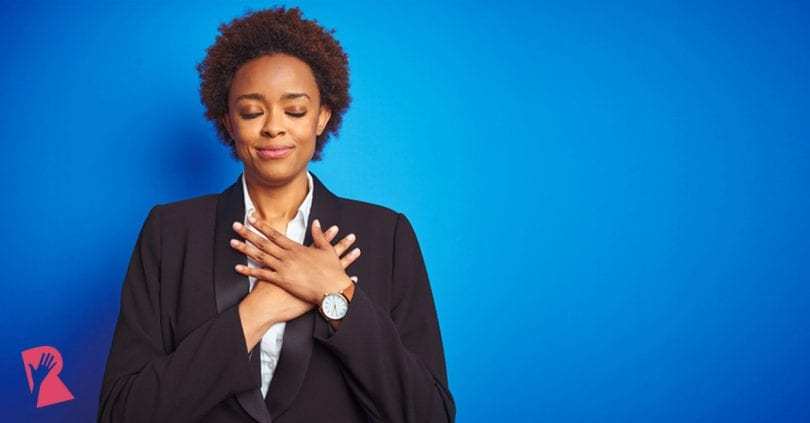 Woman holding heart considering what's important in a post-COVID world