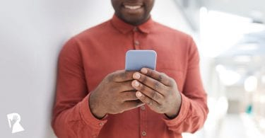 Man holding a mobile phone texting